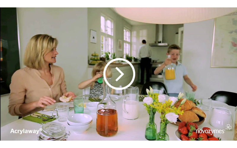 Video still of Novozymes Acrylaway video with mother and two boys sitting at a lunch table