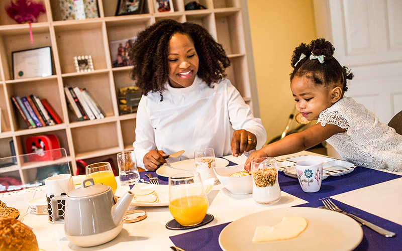 Mother and daughter enjoying breakfast