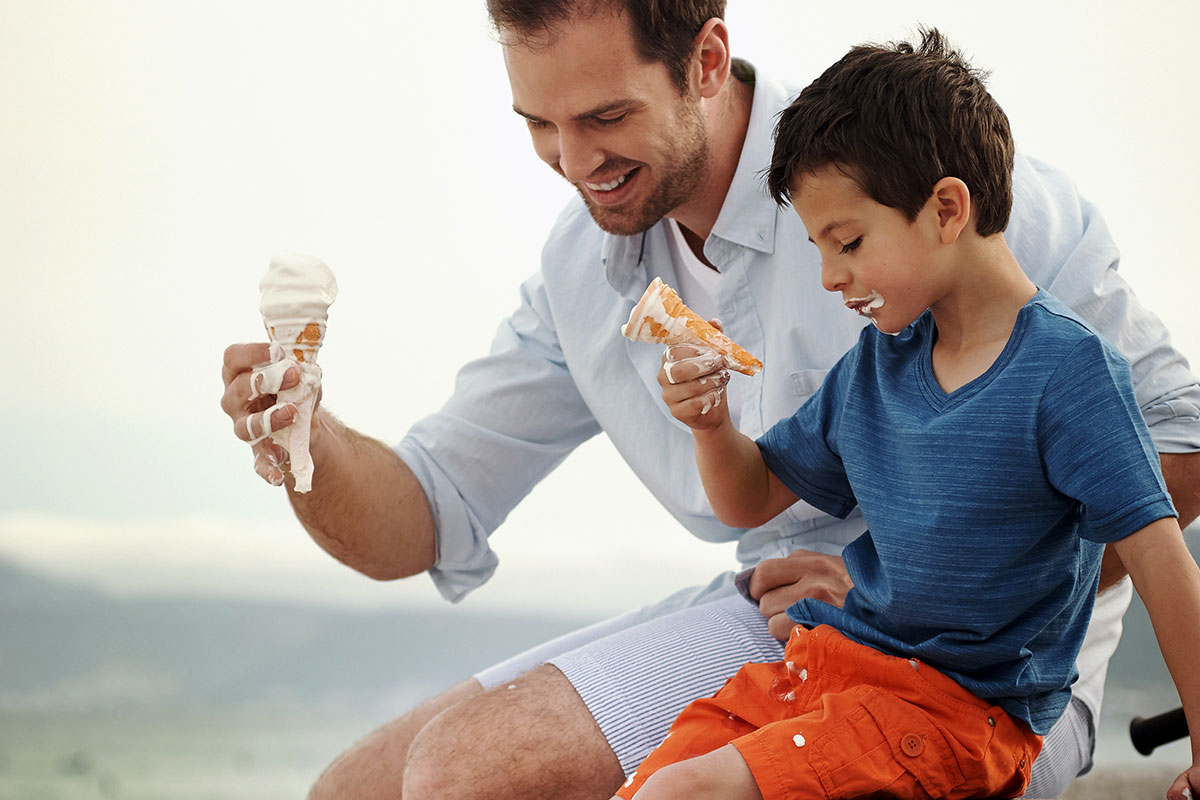Father and son enjoying their ice creams
