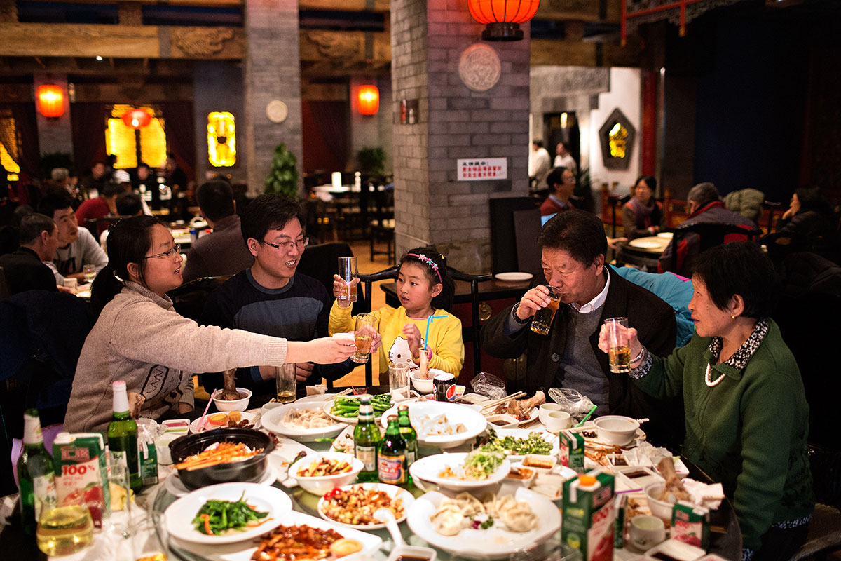 Asian family having a big dinner at a restaurant