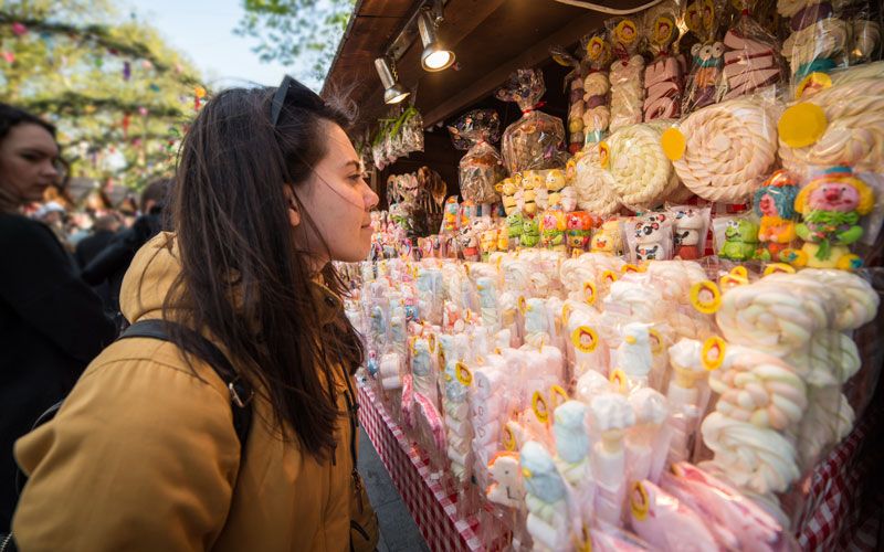 Young woman looking at a wall of candy